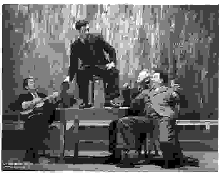 Actors on stage during a performance of Het Spel van Dr. Faust